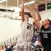 UNH's #21 Tanner Leissner jumps and extends to get a shot over Binghamton's #15 Bobby Ahearn during Saturday's American East Men's Basketball game between The University of New Hampshire and Binghamton University @ UNH's Lundholm Gymnasium on 2-14-2015.   Matt Parker Photos