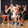 UNH's #30 Joe Bramanti gets an outlet pass and heads up the court with Binghamton's #10 Josef Yacob looking to make a steal during Saturday's American East Men's Basketball game between The University of New Hampshire and Binghamton University @ UNH's Lundholm Gymnasium on 2-14-2015.   Quinn Parker Photos