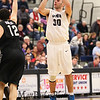 UNH's #30 Joe Bramanti takes a jump shot with Binghamton's #12 John Rinaldi defending during Saturday's American East Men's Basketball game between The University of New Hampshire and Binghamton University @ UNH's Lundholm Gymnasium on 2-14-2015.   Quinn Parker Photos