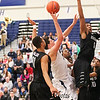 UNH's #21 Tanner Leissner gets double-teamed while making a a shot over Binghamton's #5 Magnus Richards with #11 Romello Walker  during Saturday's American East Men's Basketball game between The University of New Hampshire and Binghamton University @ UNH's Lundholm Gymnasium on 2-14-2015.   Matt Parker Photos