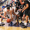 UNH's #21 Tanner Leissner and #0 Jaleen Smith attack a loose ball with Binghamton's #12 John Rinaldi getting his hand on the ball during Saturday's American East Men's Basketball game between The University of New Hampshire and Binghamton University @ UNH's Lundholm Gymnasium on 2-14-2015.   Matt Parker Photos