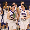 Britton Sisters Senior #24 Molly and Sophomore Emily head to the center of the court for Senior photos with their parents before Friday's Girls DIV I Basketball game between Winnacunnet and Central High Schools on 2-27-2015 @ Winnacunnet, Hampton, NH.  Matt Parker Photos