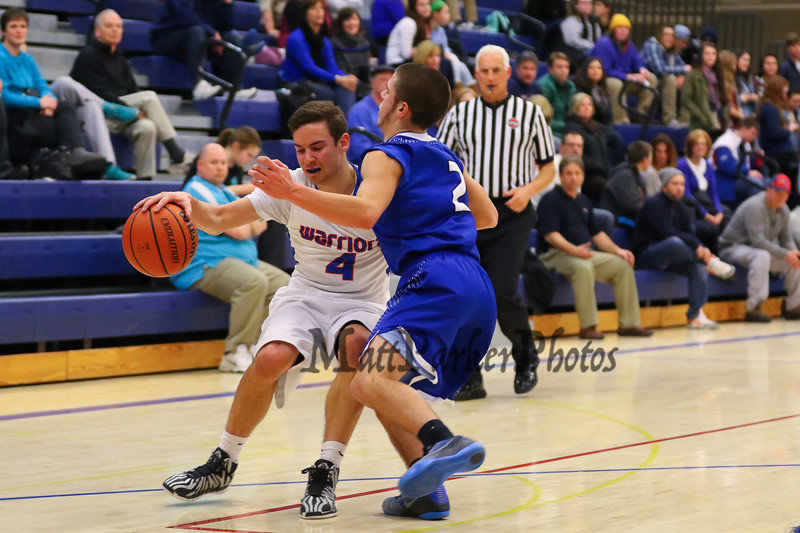 Winnacunnet's #4 Anthony Primavera finds his path blocked by Merrimack's defender #2 Chad Seaver during Tuesday's Div I Boys Basketball game between Winnacunnet and Merrimack High Schools on 2-3-2015 @ WHS.  Matt Parker Photos