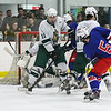 Winnacunnet's #5 Robert Warren takes a shot on goal with Kingswood's #11 Luke French and #16 Matthew Harrington defending during Wednesday's Preliminary round DIV II Hockey game between Winnacunnet and Kingswood High Schools on 3-4-2015 at Pop Whalen Ice Arena, Wolfboro, NH.  Matt Parker Photos