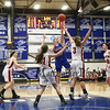 Winnacunnet's #15 Katie Valcich takes a jump shot from the key with Pinkerton's #21 Marissa Stacy and #3 Jamie Caron defending   during Monday's Div I Semi-finals Playoff Girls Basketball game between Winnacunent and Pinkerton Academy @ SNHU on 3-9-2015.  Matt Parker Photos