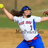 Winnacunnet's Pitcher Kristen Mackenzie goes in motion to deliver a pitch during Friday's Div I Girls Softball game between the Winnacunnet Warriors and Londonderry Lancers High Schools on Friday 4-17-2015 @ WHS.  Matt Parker Photos