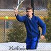 Winnacunnet's Dylan Taylor returns the ball to Londonderry during the #1 Doubles Match at Monday's Home Opener Tennis Match vs Londonderry @ Winnacunnet High School on 4-6-2015.  Matt Parker Photos