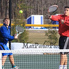 Winnacunnet's Nick Minichello (R) returns the ball over the net with teammate Dylan Taylor covering during the #1 Doubles Match at Monday's Home Opener Tennis Match vs Londonderry @ Winnacunnet High School on 4-6-2015.  Matt Parker Photos