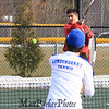 Winnacunnet's Nick Minichello returns the ball with Londonderry's Dan Pleva covering the net during the #1 Doubles Match at Monday's Home Opener Tennis Match vs Londonderry @ Winnacunnet High School on 4-6-2015.  Matt Parker Photos