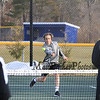 Winnacunnet's Sam Cranford steps in to meet the ball with Londonderry's Tyler Cullen covering the net during the #4 Doubles Match at Monday's Home Opener Tennis Match vs Londonderry @ Winnacunnet High School on 4-6-2015.  Matt Parker Photos