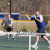 Winnacunnet's Evan Bowley makes a play on the ball while teammate Sam Cranford covers the baseline during the #4 Doubles Match at Monday's Home Opener Tennis Match vs Londonderry @ Winnacunnet High School on 4-6-2015.  Matt Parker Photos