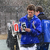 Winnacunnet's #5 Singles Player Soderberg changes the score cards with Merrimack's Andrew Trimper during Wednesday's Tennis Meet between Winnacunnet and Merrimack High Schools @ WHS on 4-8-2015.  The meet was called off due to snow early in the matches.  Matt Parker Photos