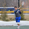 Winnacunnet's #2 Singles Player Nick Minichello makes a forehand shot to  Merrimack's Jordan Meanie during Wednesday's Tennis Meet between Winnacunnet and Merrimack High Schools @ WHS on 4-8-2015.  The meet was called off due to snow early in the matches.  Matt Parker Photos