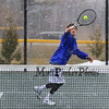 Winnacunnet's #5 Singles Player Andrew Soderberg gets to a net ball hit by Merrimack's Andrew Trimper during Wednesday's Tennis Meet between Winnacunnet and Merrimack High Schools @ WHS on 4-8-2015.  The meet was called off due to snow early in the matches.  Matt Parker Photos