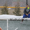 Winnacunnet's #2 Singles Player Nick Minichello gets in ready position and tracks a shot by Merrimack's Jordan Meanie during Wednesday's Tennis Meet between Winnacunnet and Merrimack High Schools @ WHS on 4-8-2015.  The meet was called off due to snow early in the matches.  Matt Parker Photos