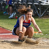 Winnacunnet's Marie Bonenfant lands in the sand pit after competing in the Girls Long Jump during Tuesday's Dual Boys and Girls DIV I Track meet between Winnacunnet and Bedford High Schools on 5-19-2015 @ WHS.  Matt Parker Photos