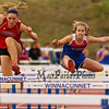 Winnacunnet Freshman Milaena Bowden clears a hurdle almost even with a Bedford hurdler in the Girls 100m hurdles during Tuesday's Dual Boys and Girls DIV I Track meet between Winnacunnet and Bedford High Schools on 5-19-2015 @ WHS.  Matt Parker Photos