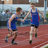 Winnacunnet's Jared McCann is passed the baton by Tommy Baker in the Boys 4x400m Relay during Tuesday's Dual Boys and Girls DIV I Track meet between Winnacunnet and Bedford High Schools on 5-19-2015 @ WHS.  Matt Parker Photos