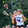 Marshwood's Defender #14 Gabrielle Bazemore reaches to control the ball with Scarborough's #18 Marielle Smith covering during Wednesday's Western Maine Class A Regional Finals between Marshwood Hawks and Scarborough Red Storm on 6-17-2015 @ Marshwood High School.  Matt Parker Photos