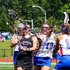 Marshwood's #2 Claudia Folger is tightly defended by Eagles #19 Calla Balboni and #10 Riley Field as she drives to the Eagle goal during  Saturday's Class A Girls Lacrosse Maine State Championship game between Marshwood and Messalonskee High Schools at Fitzpatrick Stadium, Portland ME on 6-20-2015.  Matt Parker Photos