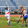 Marshwood's #17 Lindsey Poirier puts the ball past Eagles Goal Keeper #00 Syndi Collier during  Saturday's Class A Girls Lacrosse Maine State Championship game between Marshwood and Messalonskee High Schools at Fitzpatrick Stadium, Portland ME on 6-20-2015.  Matt Parker Photos