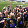 Marshwood's #14 Gabrielle Basemore raises her hand in the air in celebration with her teammates after winning Saturday's Class A Girls Lacrosse Maine State Championship game between Marshwood and Messalonskee High Schools at Fitzpatrick Stadium, Portland ME on 6-20-2015.  Matt Parker Photos