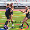 Marshwood's Goal Keeper #54 Emily Kahler is mobbed by teammates after winning Saturday's Class A Girls Lacrosse Maine State Championship game between Marshwood and Messalonskee High Schools at Fitzpatrick Stadium, Portland ME on 6-20-2015.  Matt Parker Photos