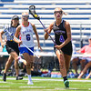 Marshwood's #4 Marin Smith runs the ball up the field during  Saturday's Class A Girls Lacrosse Maine State Championship game between Marshwood and Messalonskee High Schools at Fitzpatrick Stadium, Portland ME on 6-20-2015.  Matt Parker Photos