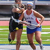Marshwood's #18 Korinne Bohunsky and Eagles #7 Lydia Dexter reach for the loose ball after the draw during  Saturday's Class A Girls Lacrosse Maine State Championship game between Marshwood and Messalonskee High Schools at Fitzpatrick Stadium, Portland ME on 6-20-2015.  Matt Parker Photos