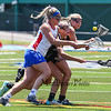 Marshwood's #4 Marin Smith gets sandwiched between teammate #18 Korinne Bohunsky and Eagles #7 Lydia Dexter while going for a loose ball during Saturday's Class A Girls Lacrosse Maine State Championship game between Marshwood and Messalonskee High Schools at Fitzpatrick Stadium, Portland ME on 6-20-2015.  Matt Parker Photos