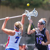 Marshwood's #17 Lindsey Poirier and Eagles #7 Lydia Dexter look to control the ball during a draw at  Saturday's Class A Girls Lacrosse Maine State Championship game between Marshwood and Messalonskee High Schools at Fitzpatrick Stadium, Portland ME on 6-20-2015.  Matt Parker Photos