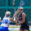 Marshwood's #18 Korinne Bohunsky looks for an open teammate to pass with Eagles #18 Nathalie St. Pierre defending during Saturday's Class A Girls Lacrosse Maine State Championship game between Marshwood and Messalonskee High Schools at Fitzpatrick Stadium, Portland ME on 6-20-2015.  Matt Parker Photos