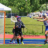 Marshwood's Goal Keeper #54 Emily Kahler comes of of the goal to defend against a shot by Eagles #18 Nathalie St. Pierre during  Saturday's Class A Girls Lacrosse Maine State Championship game between Marshwood and Messalonskee High Schools at Fitzpatrick Stadium, Portland ME on 6-20-2015.  Matt Parker Photos