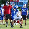Freshman Tate Cooper gets low to make a catch during a receiver drill at the 2015 Winnacunnet Warriors Veer Camp on Sunday 8-2-2015 @ Winnacunnet High School.  Matt Parker Photos