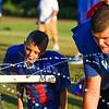 3rd grader Mason McDonald and Winnacunnet's Seth Provencher take a break for a drink of water at the 2015 Winnacunnet Warriors Veer Camp on Sunday 8-2-2015 @ Winnacunnet High School.  Matt Parker Photos