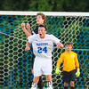 Winnacunnet's #24 Freddy Schaake and Bulldogs #4 Joshua Bauer go up for a head ball during Thursday's Div I Boys Soccer Game between Winnacunnet and Bedford High Schools on 9-17-2015 @ WHS.  Matt Parker Photos