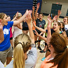 Winnacunnet Freshman Girls with Coach Cassiopeia Turcotte give high-fives after Wednesday's practice @ WHS on 9-2-2015.  Matt Parker Photos