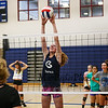 Winnacunnet So. Sadie Gaskell works on a net blocking drill with Coach Lori Garand  during the Winnacunnet Girls Volleyball practice on Wednesday @ WHS on 9-2-2015.  Matt Parker Photos
