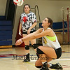 Winnacunnet Senior Captain Meg Knollmeyer gets low in order to set a short hit ball during Wednesday's Girls Volleyball practice on 9-2-2015 @ WHS.  Matt Parker Photos