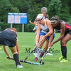 Winnacunnet's #5 Isobel Sargent works her way through Bedford defenders #17 Meaghan Winn (L) and #14 Brionne Frazier (R) rduring Monday's Girls Div I Field Hockey game between the Winnacunnet Warriors and the Bulldogs of Bedford on Monday 9-28-2015 @ WHS. Matt Parker Photos