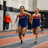 Winnacunnet's Sarah DeMello passes the batton off to Mikhaela Acuna-Stevenson in the Girls 4x160m Relay finishing in a time of 1:37.80 at the NH Indoor Track and Field League Evening Session Meet #4  on 1-11-2014 @ the UNH Paul Sweet Oval, Durham, NH.  Matt Parker Photos