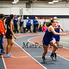 Winnacunnet's Savanna Spencer grabs the batton from teammate Catherine Shanley in the Girls 4x400m Relay at the NH Indoor Track and Field League Evening Session Meet #4  on 1-11-2014 @ the UNH Paul Sweet Oval, Durham, NH.  Matt Parker Photos