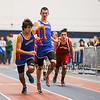 Winnacunnet's Ryan Hanley passes the batton off to Gabriel Vaca Enriquez in the Boys 4x160m Relay finishing in a time of 1:23.20 taking 4th place at the NH Indoor Track and Field League Evening Session Meet #4  on 1-11-2014 @ the UNH Paul Sweet Oval, Durham, NH.  Matt Parker Photos