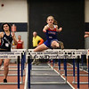 Winnacunnet's Caitlin Capezzuto clears a hurdle in the Girls 55 m Hurdles finishing with a time of 11.30 on Sunday at the NH Indoor Track and Field League Evening Session Meet #4  on 1-11-2014 @ the UNH Paul Sweet Oval, Durham, NH.  Matt Parker Photos