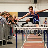 Winnacunnet's John Rooney clears a hurdle in the Boys 55 m Hurdles finishing with a time of 10.90 on Sunday at the NH Indoor Track and Field League Evening Session Meet #4  on 1-11-2014 @ the UNH Paul Sweet Oval, Durham, NH.  Matt Parker Photos