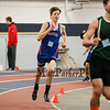 Winnacunnet's Freshman Devan Sack rounds a turn in the Boys 600m run finishing with a time of 1:46.50 on Sunday at the NH Indoor Track and Field League Evening Session Meet #4  on 1-11-2014 @ the UNH Paul Sweet Oval, Durham, NH.  Matt Parker Photos
