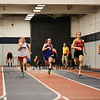 Winnacunnet's Catherine Shanley runs a 7.70 in the Girls 55 m Dash while holding off Londonderry's Andrea Wooldridge which is good for Winnacunnet 3rd place finish on Sunday at the NH Indoor Track and Field League Evening Session Meet #4  on 1-11-2014 @ the UNH Paul Sweet Oval, Durham, NH.  Matt Parker Photos