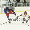 Winnacunnet's #9 James Nash takes a shot with Lebanon's #16 Nathan Kriplin defending  during Satruday's Div II Hockey game between Winnacunnet and Lebanon High Schools on 1-17-2015 @ Champion Arena West Lebanon, NH.  Matt Parker Photos