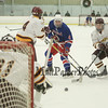 Winnacunnet's #4 Casey Glynn takes a shot with Lebanon's #7 Brendan Kelley, #4 Noah Gaudette and Goalie #31 Chad Fazio defending during Satruday's Div II Hockey game between Winnacunnet and Lebanon High Schools on 1-17-2015 @ Champion Arena West Lebanon, NH.  Matt Parker Photos
