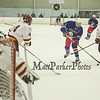 Winnacunnet's #4 Casey Glynn keeps his stick on the puck as he makes a play on the net with Lebanon's #7 Brendan Kelley, #4 Noah Gaudette and Goalie #31 Chad Fazio defending during Satruday's Div II Hockey game between Winnacunnet and Lebanon High Schools on 1-17-2015 @ Champion Arena West Lebanon, NH.  Matt Parker Photos